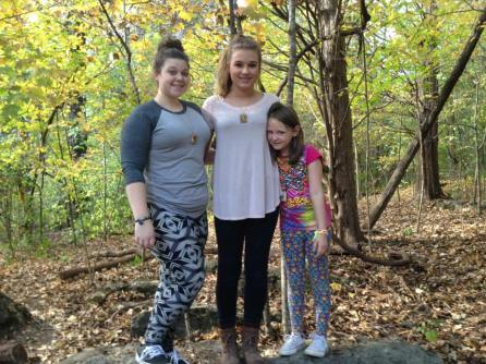 Our children pose for a picture on a trail laden with fall leaves.